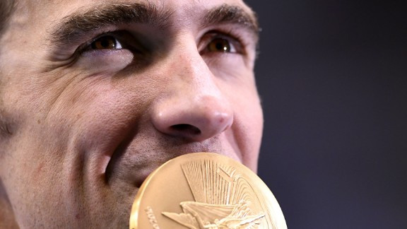 U.S. swimmer Michael Phelps -- the most decorated Olympian of all time -- kisses his gold medal from the 4x200 freestyle on Tuesday, August 9. Phelps finished the Rio Games with five gold medals and one silver. He ends his Olympic career with 23 gold medals and 28 medals overall.