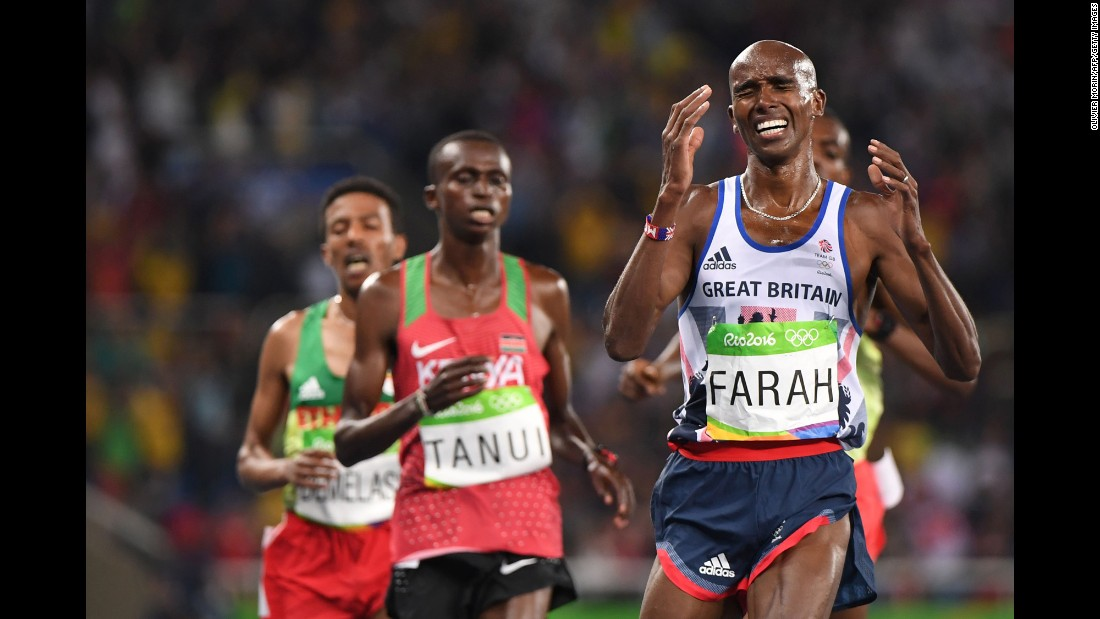 British runner Mo Farah crosses the finish line to successfully defend his 10,000-meter title on Saturday, August 13.