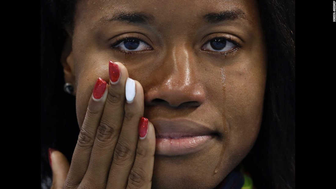"U.S. swimmer Simone Manuel cries during the medal ceremony after <a href=""http://www.cnn.com/2016/08/14/sport/rio-olympics-manuel-usa-1000-golds/"" target=""_blank"">winning the 100-meter freestyle</a> on Friday, August 12. Manuel is the first African-American woman to win an individual swimming event in the Olympics."