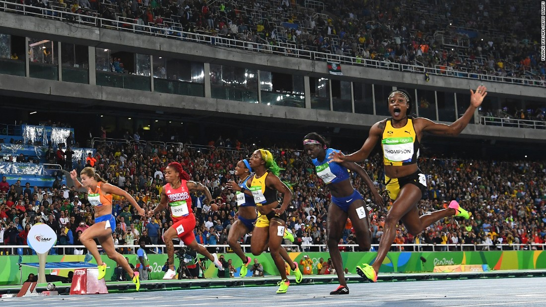 "Jamaica's Elaine Thompson, right, wins the 100-meter final -- and the title of <a href=""http://www.cnn.com/2016/08/13/sport/elaine-thompson-olympic-games-rio-2016/"" target=""_blank"">world's fastest woman</a> -- on Saturday, August 13."