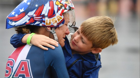 American cyclist Kristin Armstrong hugs her son, Lucas, after winning the time trial for the third straight Olympics on Wednesday, August 10. Williams won gold at the event a day before turning 43 years old. She was the oldest woman in the field by seven years.