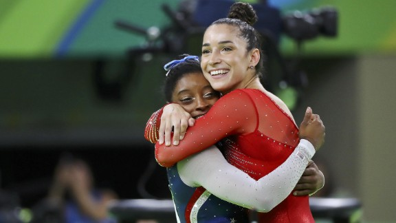 U.S. gymnasts Simone Biles, left, and Aly Raisman hug after winning gold and silver in the individual all-around on Thursday, August 11.