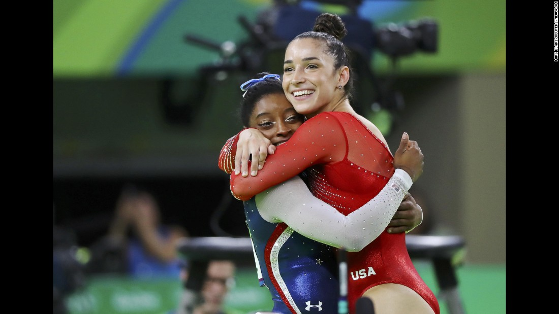 "U.S. gymnasts Simone Biles, left, and Aly Raisman hug after winning gold and silver in <a href=""http://www.cnn.com/2016/08/11/sport/simone-biles-usa-gymnastics-rio/"" target=""_blank"">the individual all-around</a> on Thursday, August 11."