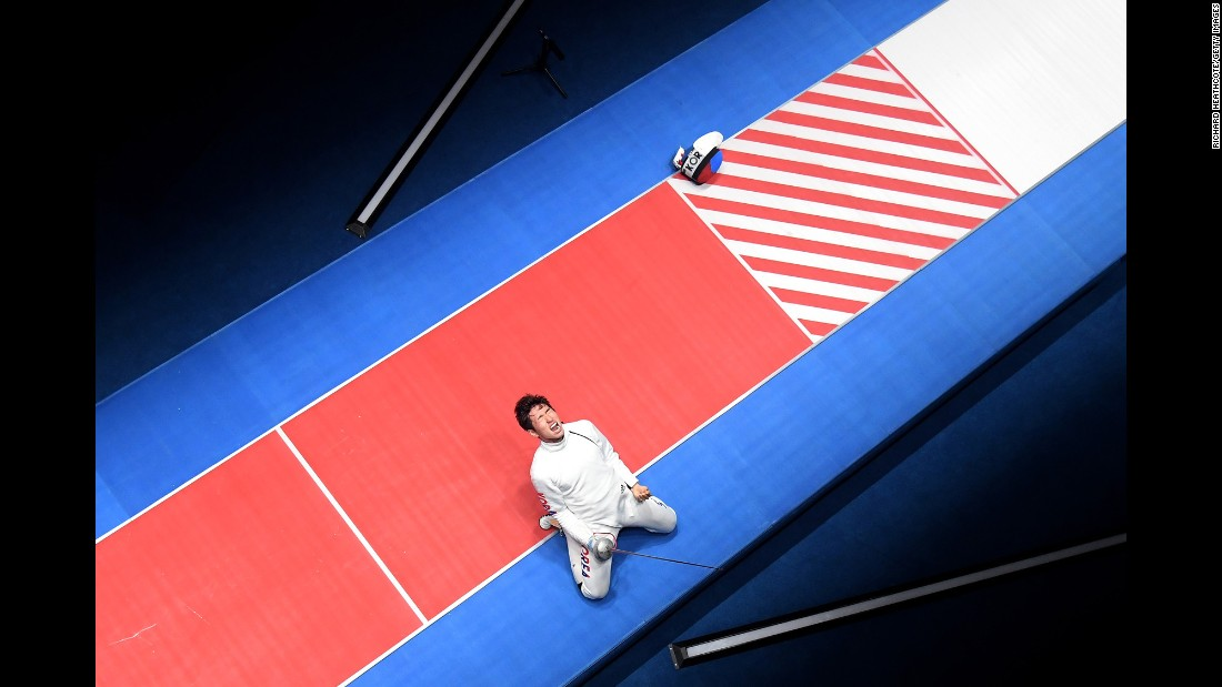 South Korean fencer Park Sang-young celebrates after he won gold in the individual epee competition on Tuesday, August 9.