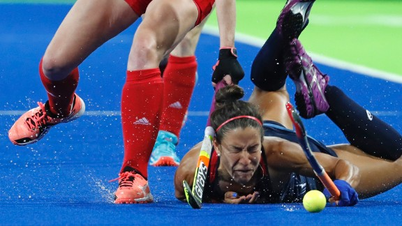 U.S. field hockey player Melissa Gonzalez falls to the turf during a match against Great Britain on Saturday, August 13.