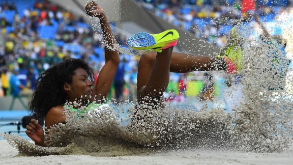 Brazilian athlete Nubia Soares lands in the sand pit while competing in the triple jump on Saturday, August 13.