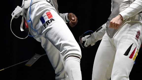A cell phone falls out of the pocket of French fencer Enzo Lefort as he competes against Germany's Peter Joppich on Sunday, August 7.