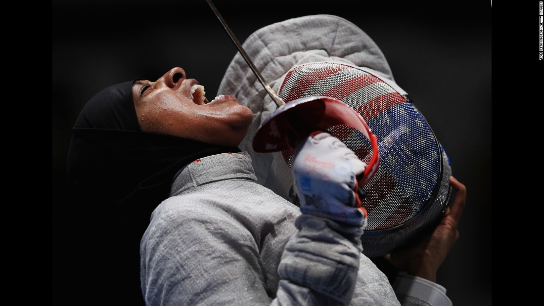 "Ibtihaj Muhammad, the first U.S. Olympian <a href=""http://www.cnn.com/2016/08/08/sport/ibtihaj-muhammad-individual-sabre-fencing-2016-rio-olympics/"" target=""_blank"">to compete in a hijab,</a> reacts during a sabre fencing semifinal on Saturday, August 13. Her team lost to Russia but still took home the bronze."