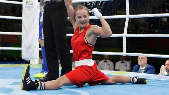 Ukrainian boxer Tetyana Kob celebrates after she won a flyweight bout on Friday, August 12.