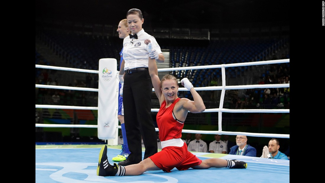 Ukrainian boxer Tetyana Kob celebrates after she won a flyweight bout on Friday, August 12.