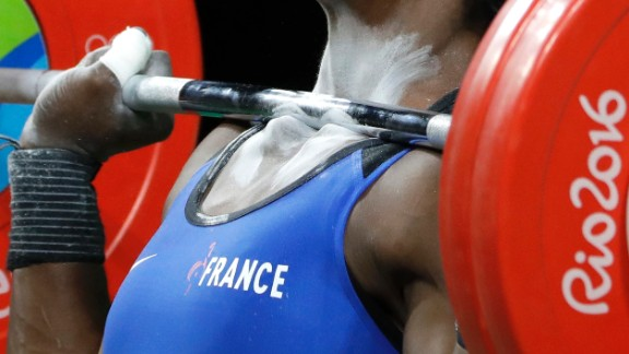 A barbell rests on the collarbones of French weightlifter Gaelle Nayo-Ketchanke as she performs a clean-and-jerk lift on Friday, August 12.