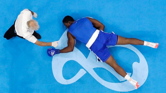 Nigel Paul, a super-heavyweight boxer from Trinidad and Tobago, lies on the canvas after being knocked out by Nigeria's Efe Ajagba on Saturday, August 13.