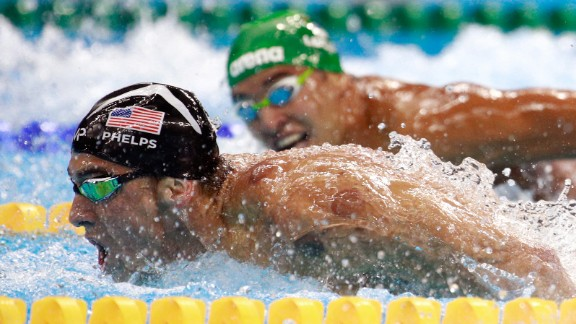 South Africa's Chad Le Clos, right, looks over at Michael Phelps during the 200-meter butterfly final on Tuesday, August 9. Phelps' victory avenged one of the few losses of his Olympic career -- a second-place finish to Le Clos in 2012.