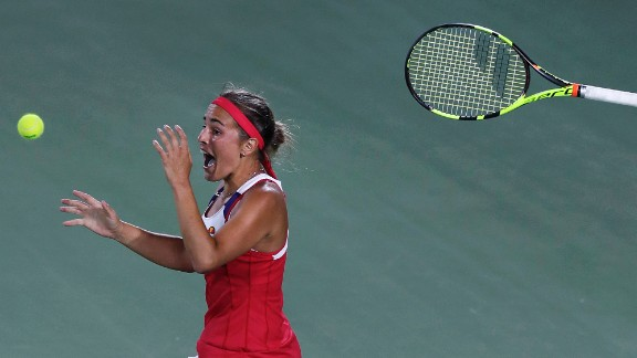 Monica Puig tosses her racket after winning Puerto Rico's first Olympic gold medal on Saturday, August 13. Puig defeated Germany's Angelique Kerber in three sets, becoming the first unseeded player to win gold since women's tennis was reintroduced in 1988.