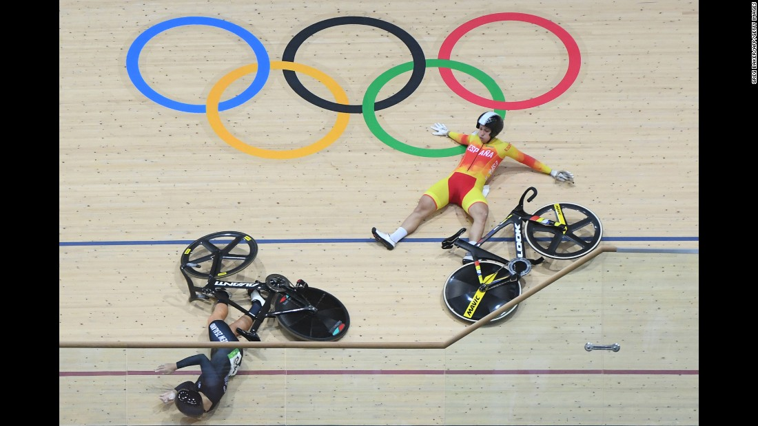 New Zealand's Olivia Podmore, left, and Spain's Tania Calvo Barbero fall during a keirin race on Saturday, August 13.