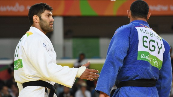 Israel's Or Sasson offers a handshake to Egypt's Islam El Shehaby after their judo match on Friday, August 12. El Shehaby refused and was later sent home by the Egyptian Olympic Committee.