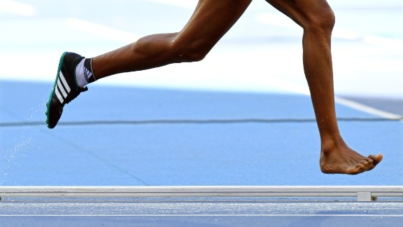 Ethiopia's Etenesh Diro runs with one bare foot after losing a shoe during the 3,000-meter steeplechase on Saturday, August 13. She still finished the race and advanced to the final.