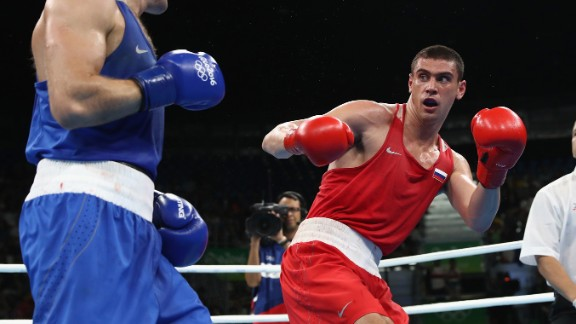 Russia's Evgeny Tishchenko, in red, won a a decision over Kazahkstan's Vassiliy Levit, left, in the heavyweight final. But he was booed on the medal stand by fans who felt Levit deserved the victory.