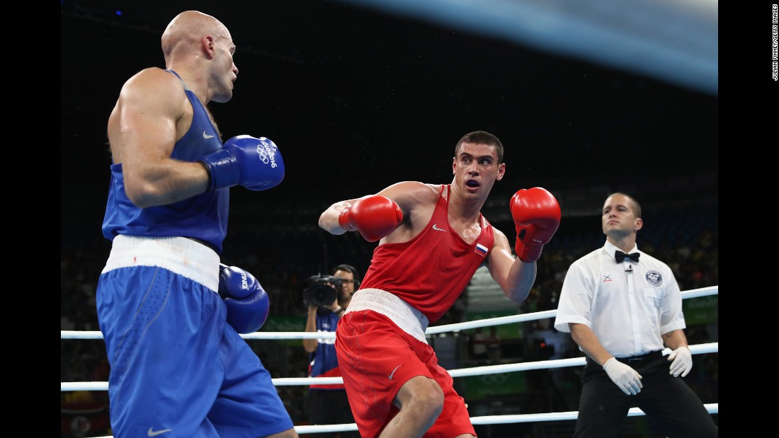 "Russia's Evgeny Tishchenko, in red, won a a decision over Kazahkstan's Vassiliy Levit, left, in the heavyweight final. But he was <a href=""http://www.cnn.com/2016/08/15/sport/olympic-boxing-evgeny-tishchenko/index.html"" target=""_blank"">booed on the medal stand</a> by fans who felt Levit deserved the victory."
