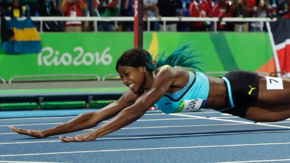 Shaunae Miller of the Bahamas dives over the finish line to win gold in the 400 meters on Monday, August 15. She edged American Allyson Felix by .07 seconds.