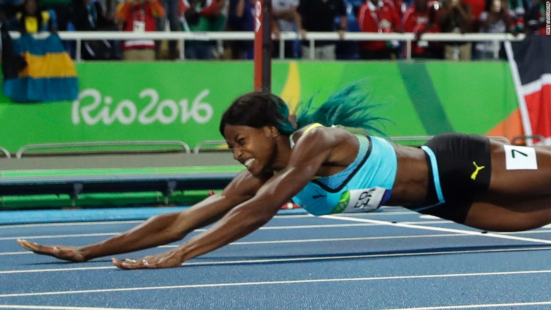 "Shaunae Miller of the Bahamas <a href=""http://edition.cnn.com/2016/08/15/sport/allyson-felix-athletics-olympics/index.html"" target=""_blank"">dives over the finish line</a> to win gold in the 400 meters on Monday, August 15. She edged American Allyson Felix by .07 seconds."