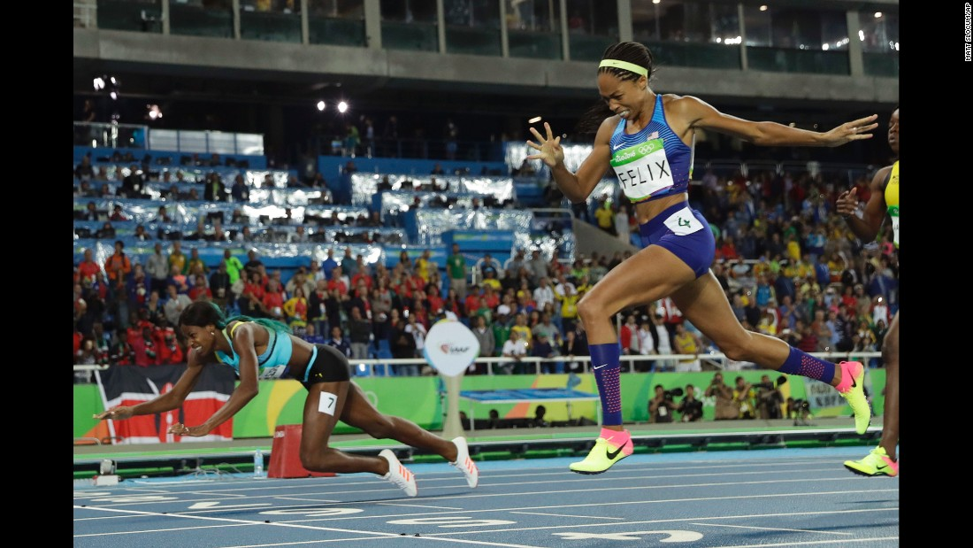 "Shaunae Miller of the Bahamas <a href=""http://edition.cnn.com/2016/08/15/sport/allyson-felix-athletics-olympics/index.html"" target=""_blank"">dives over the finish line</a> to win gold in the 400 meters on Monday, August 15. She edged out American Allyson Felix by .07 seconds."