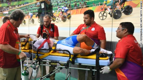 South Korea's Park Sanghoon is stretchered off after crashing during the men's omnium points race.