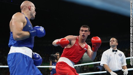RIO DE JANEIRO, BRAZIL - AUGUST 15:  Evgeny Tishchenko of Russia fights Vassiliy Levit of Kazakhstan for the gold medal in the mens heavyweight 91kg during the Boxing at Riocentro on August 15, 2016 in Rio de Janeiro, Brazil.  (Photo by Julian Finney/Getty Images)
