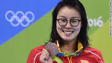 China's Fu Yuanhui poses with her bronze medal on the podium of the Women's 100m Backstroke during the swimming event at the Rio 2016 Olympic Games at the Olympic Aquatics Stadium in Rio de Janeiro on August 8, 2016.   / AFP / GABRIEL BOUYS        (Photo credit should read GABRIEL BOUYS/AFP/Getty Images)