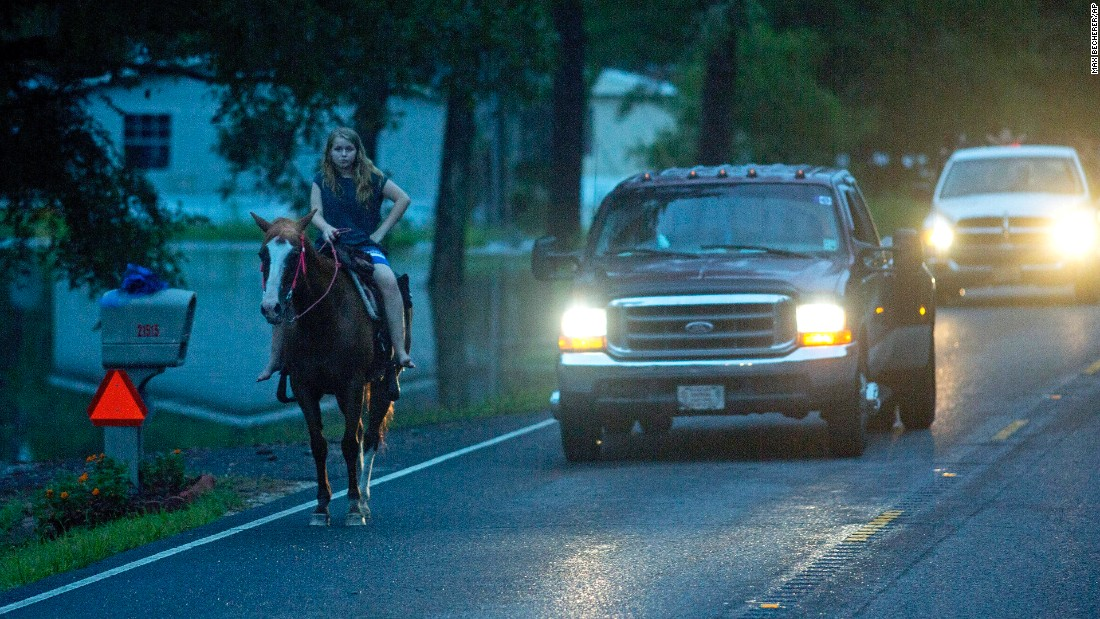A girl takes her horse out on a dry road near Walker on August 14.