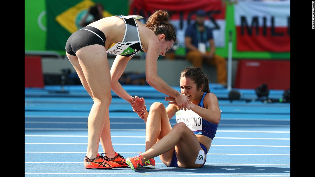 "New Zealand's Nikki Hamblin, left, helps Abbey D'Agostino of the United States <a href=""http://www.nbcolympics.com/video/us-runner-finishes-race-after-falling-hard"" target=""_blank"">after they collided</a> during the 5,000-meter semifinal. Both runners managed to finish the race."