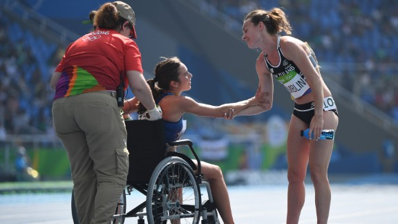 Abbey D'Agostino of the United States leaves the track on a wheelchair after twisting her ankle in the 5000-meter semifinal on Tuesday, August 16. D'Agostino and New Zealand's Nikki Hamblin, right, collided during the race but helped each other up and managed to make it to the finish line.