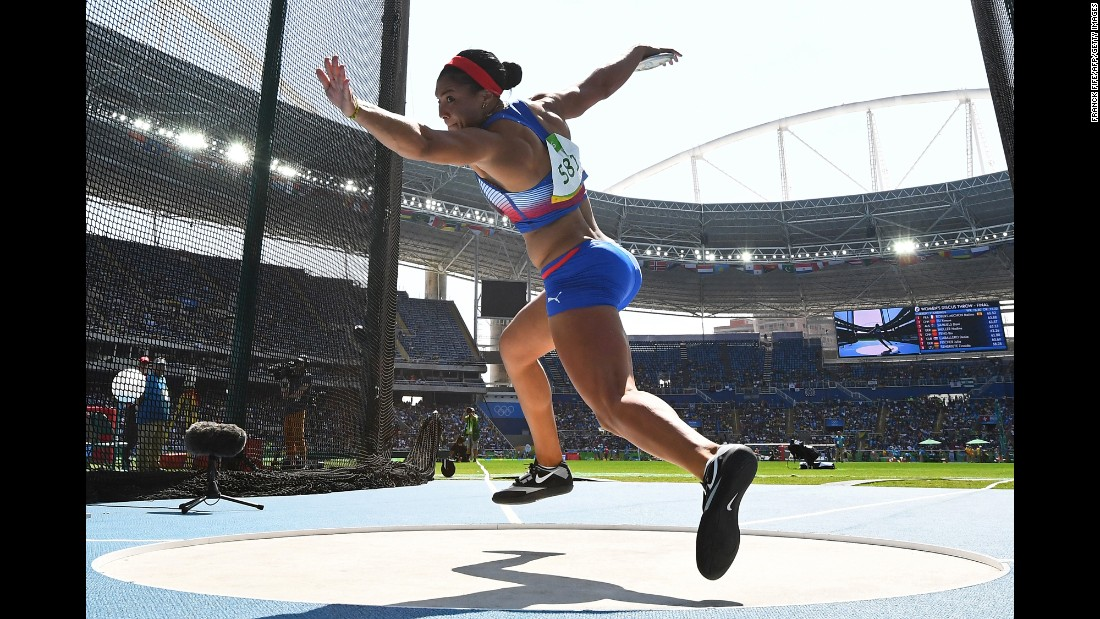 Cuba's Yaime Perez competes in the discus throw final.