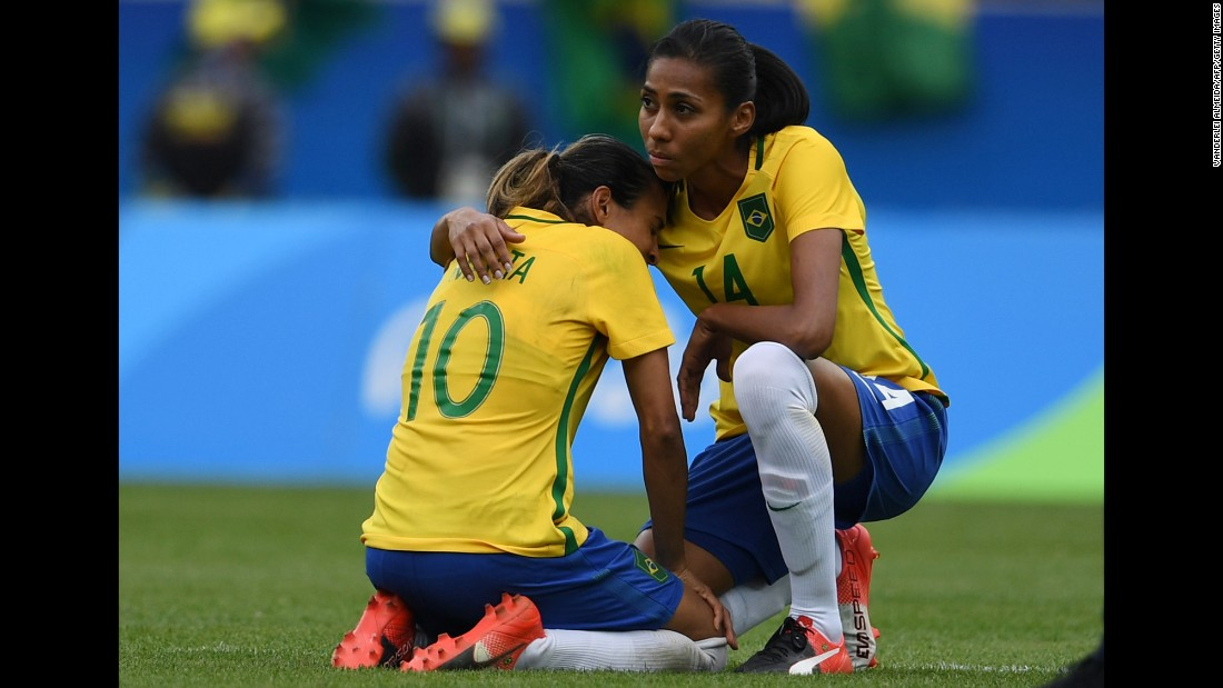 "Bruna comforts her Brazilian teammate Marta after <a href=""http://edition.cnn.com/2016/08/16/sport/brazil-womens-football-sweden-semifinal-olympics/index.html"" target=""_blank"">they lost to Sweden</a> in the soccer semifinals. The match was decided on penalty kicks after a goalless draw."