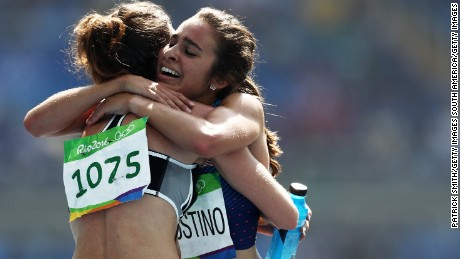 Abbey D'Agostino of the US (R) hugs New Zealand's Nikki Hamblin after the women's 5000m heats.