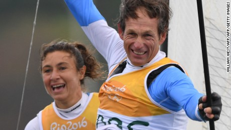 Argentina's Santiago Lange and Cecilia Carranza Saroli celebrate after winning the Nacra 17 Mixed medal race at Marina da Gloria during the Rio 2016 Olympic Games in Rio de Janeiro on August 16, 2016 / AFP / WILLIAM WEST        (Photo credit should read WILLIAM WEST/AFP/Getty Images)