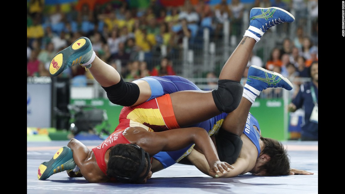 Brazilian freestyle wrestler Joice Silva, in red, competes against Kyrgyzstan's Aisuluu Tynybekova in a 58-kilogram (128-pound) qualification round.