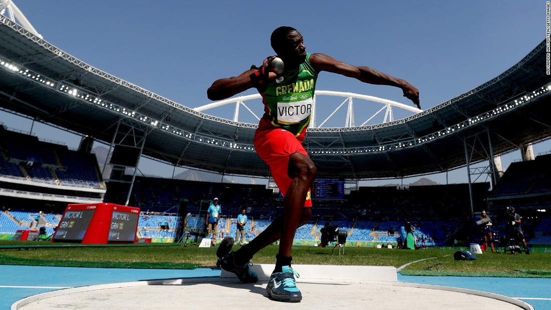 Lindon Victor of Grenada competes in the decathlon shot put.