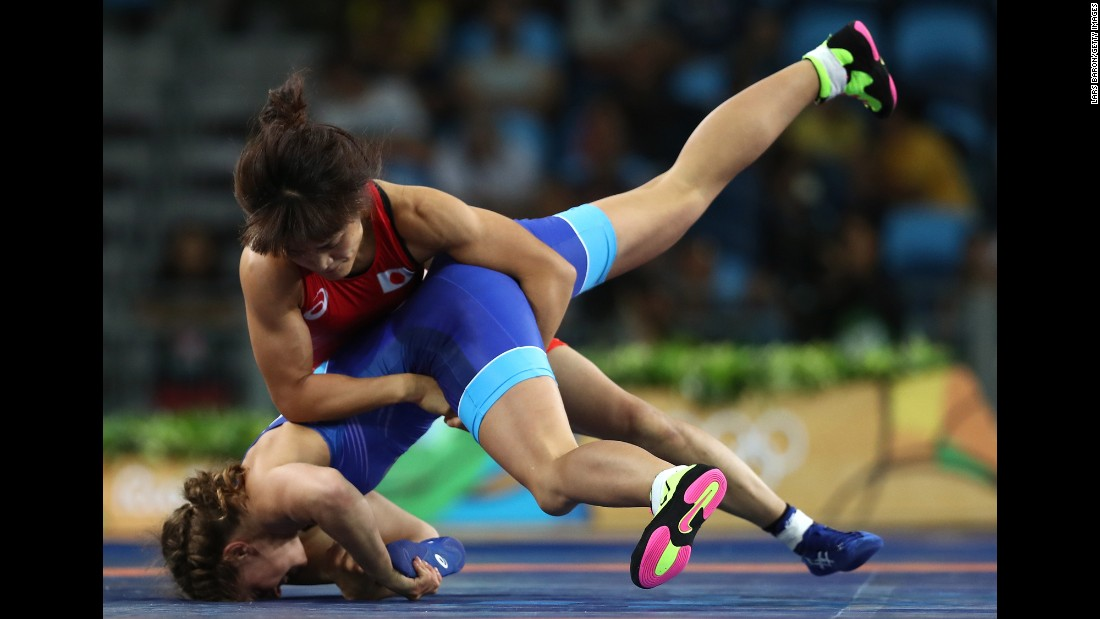 "Japanese wrestler Kaori Icho, in red, defeated Russia's Valeria Koblova for the gold medal in the 58-kilogram (128-pound) weight class. It was the <a href=""http://www.cnn.com/2016/08/17/sport/kaori-icho-wrestling-rio/index.html"" target=""_blank"">fourth straight Olympic gold medal</a> for Icho, who became the first female in any sport to win an individual-event gold at four Olympics."