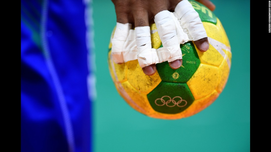An athlete grips a handball during the quarterfinal round.