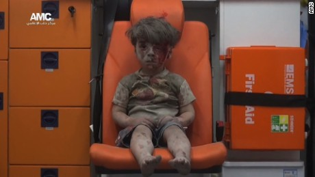 Little boy in Aleppo a vivid reminder of war's horror