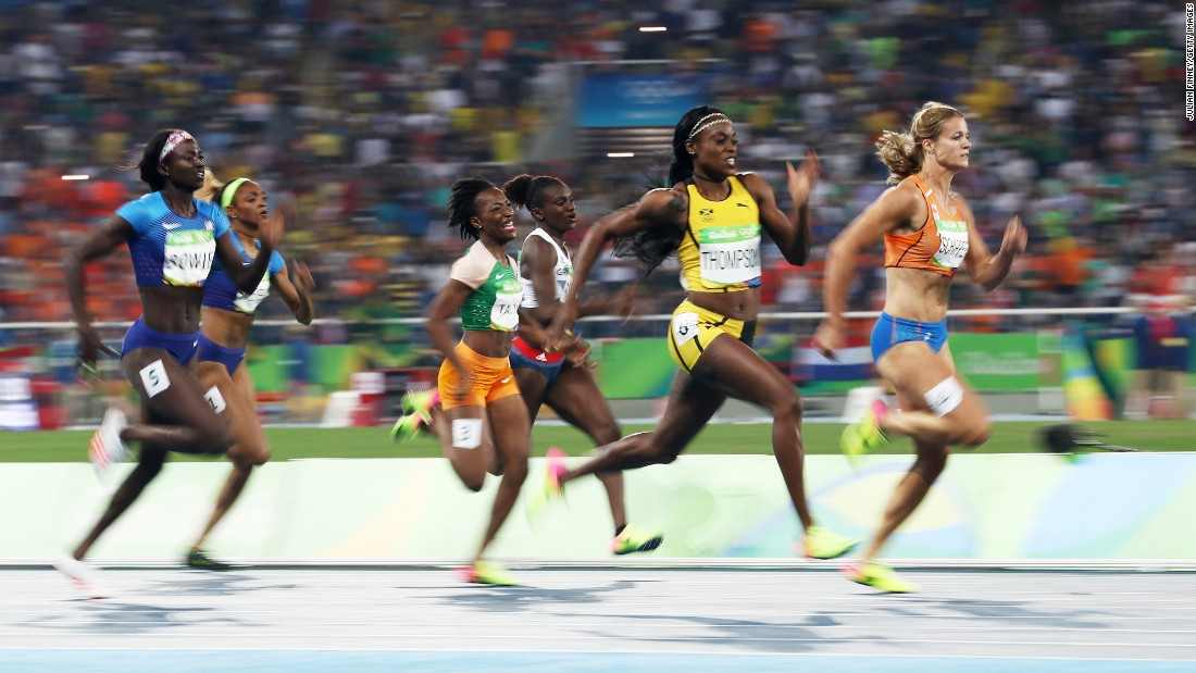 Jamaica's Elaine Thompson, second from right, edges the Netherlands' Dafne Schippers to win gold in the 200 meters. Thompson also won the 100-meter gold last week.