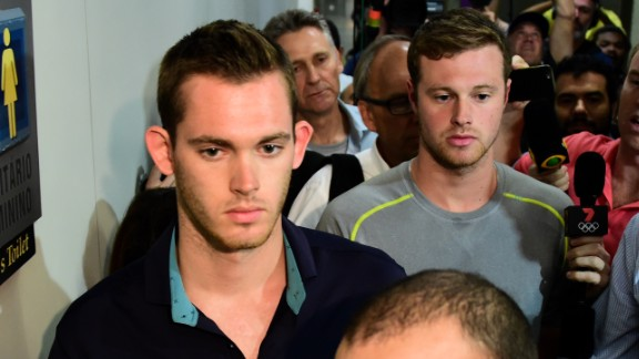 American swimmers Gunnar Bentz (L) and Jack Conger leave the police station at the Rio de Janeiro International Airport after being detained on the plane that would travel back to the US.   Brazilian police arrested two US swimmers and a top International Olympic Committee official as scandal overshadowed the Rio Games and Usain Bolt
