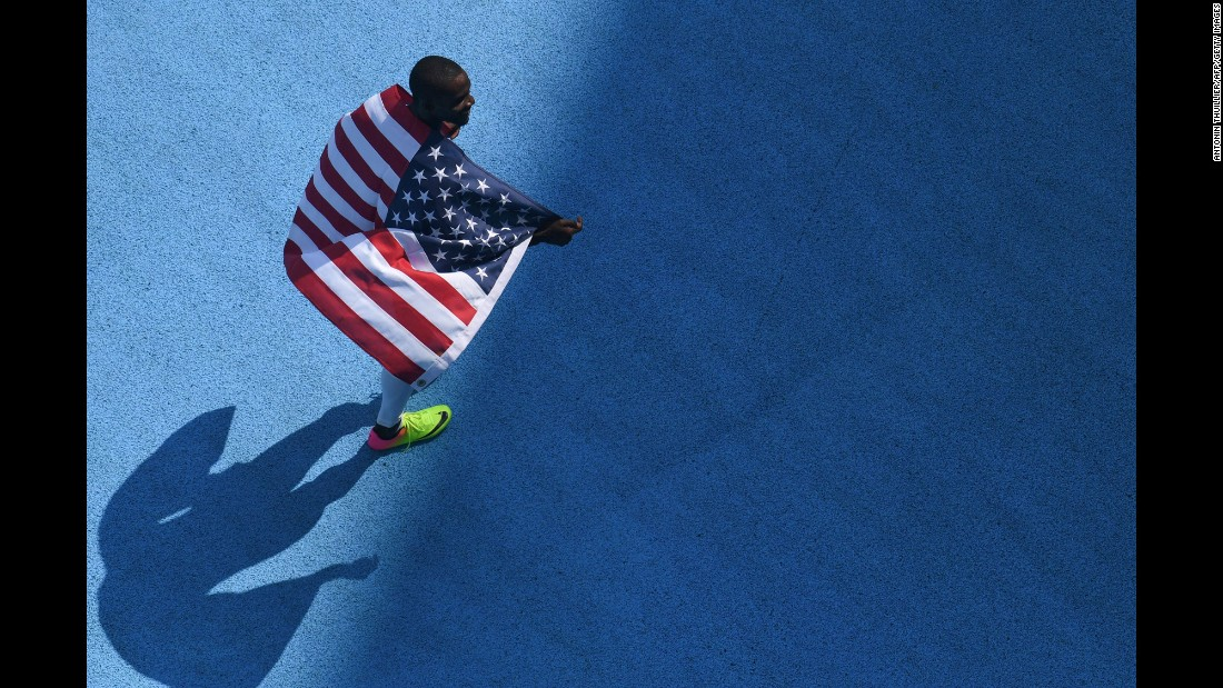 Kerron Clement of the United States celebrates winning gold in the 400-meter hurdles.