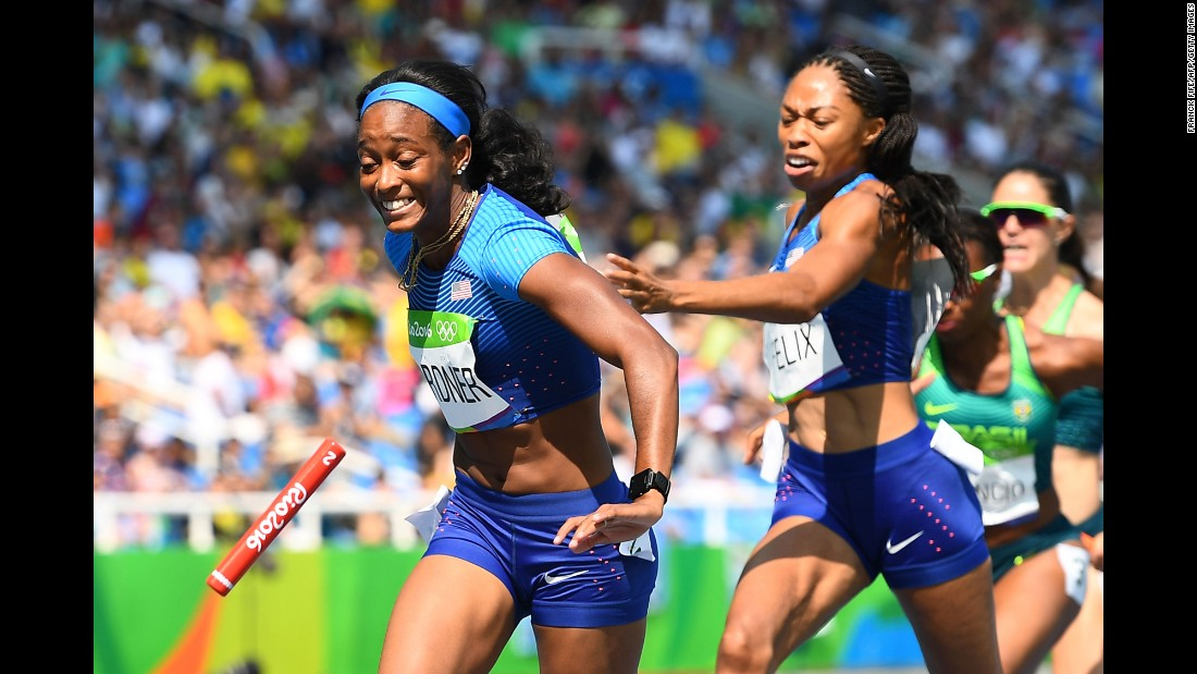 American Allyson Felix tries to hand the baton to teammate English Gardner  in a 4x100-