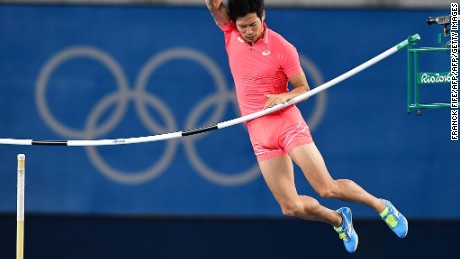 Japan's Hiroki Ogita competes in the Men's Pole Vault Qualifying Round during the athletics event at the Rio 2016 Olympic Games at the Olympic Stadium in Rio de Janeiro on August 13, 2016.