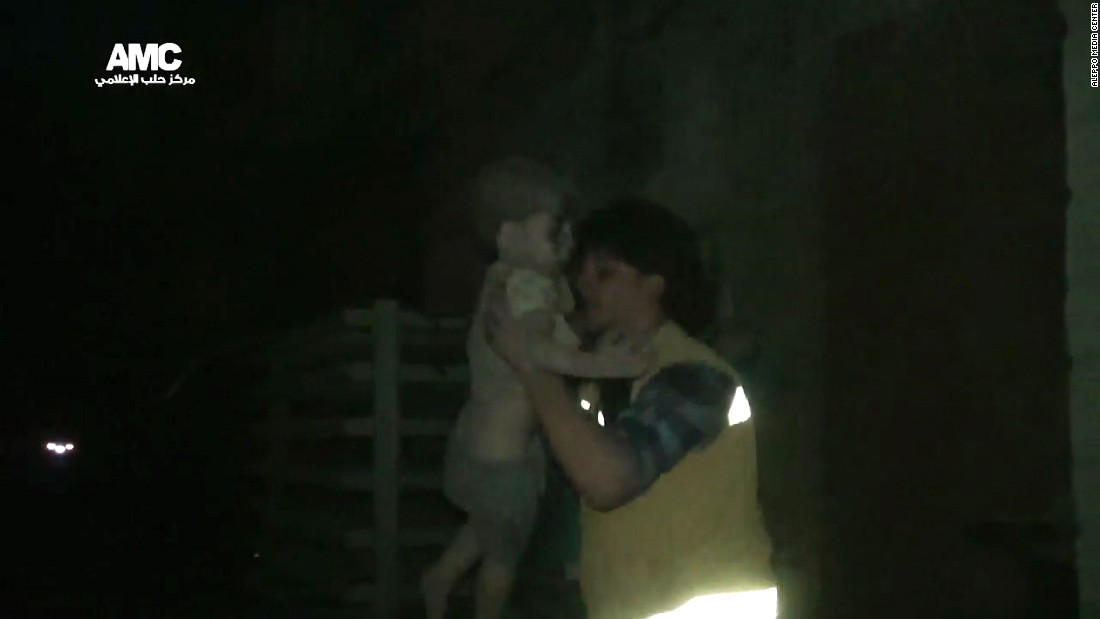 "A civil defense worker carries Omran into the ambulance. The airstrike destroyed Omran's home, where he lived with his parents and two siblings. Director of the Aleppo Media Center Yousef Saddiq said Omran's 10-year-old brother, Ali, <a href=""http://www.cnn.com/2016/08/20/middleeast/syria-conflict/index.html"" target=""_blank"">died from his injuries</a> on Saturday, August 20."