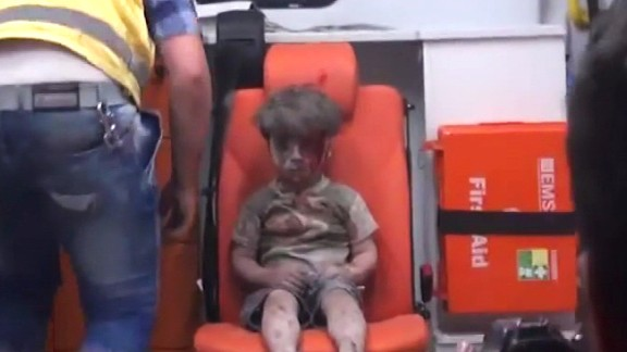 The bloodied boy sits and waits for medical attention. An Aleppo Media Center activist told CNN that Omran did not cry at any point during the rescue and appeared to be in extreme shock.