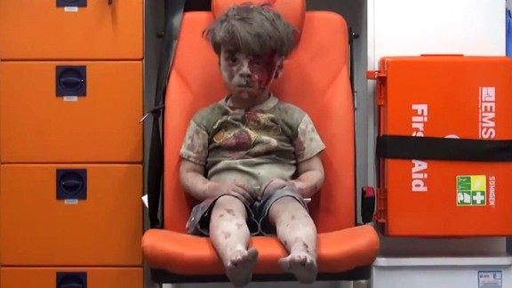 This still image, taken from a video posted by the Aleppo Media Center, shows a young boy in an ambulance after an airstrike in the northern Syrian city of Aleppo on Wednesday, August 17. The boy has been identified as Omran Daqneesh, and the video of him has been circulating on social media.