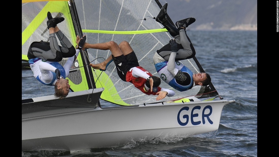 Germany's Erik Heil and Thomas Ploessel celebrate winning bronze in the 49er class.